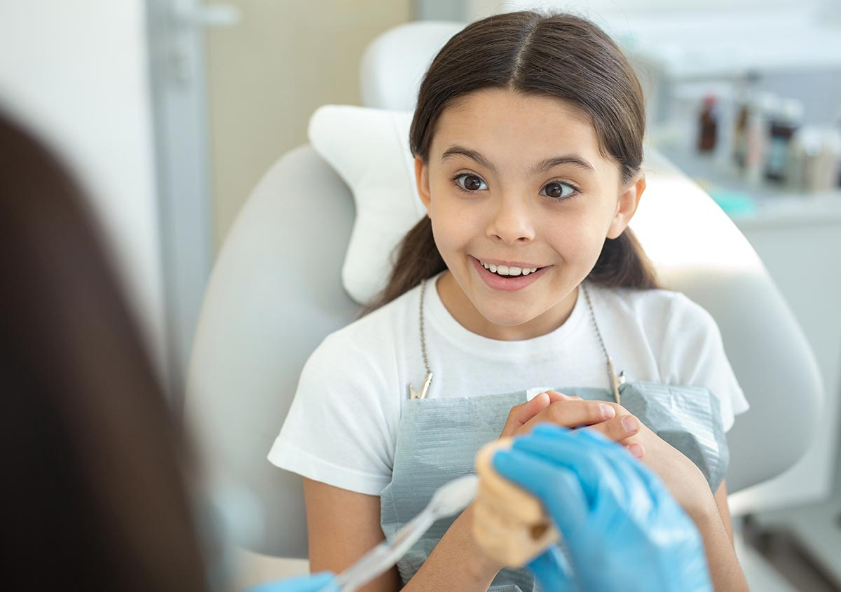 Child smiling at the dental