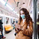 Woman in the train wearing mask
