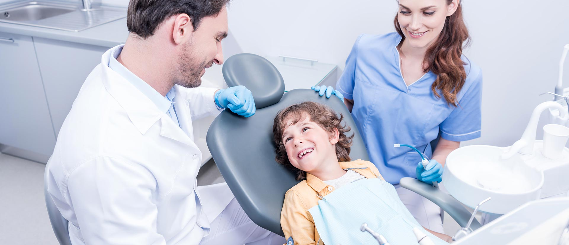 A child is smiling at the dental care