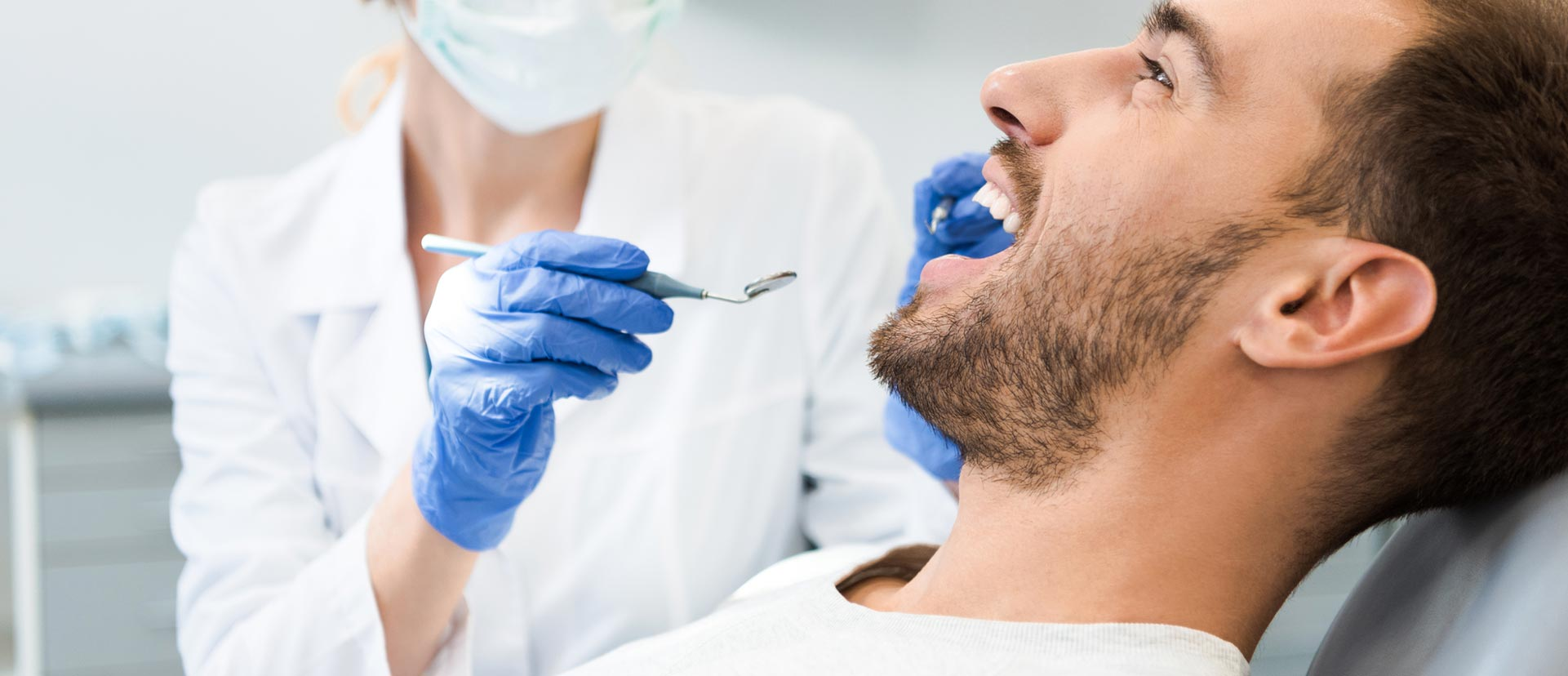 A man is smiling at the dental clinic