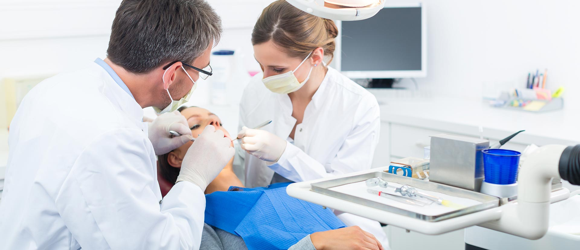 Dentists are performing a dental surgery