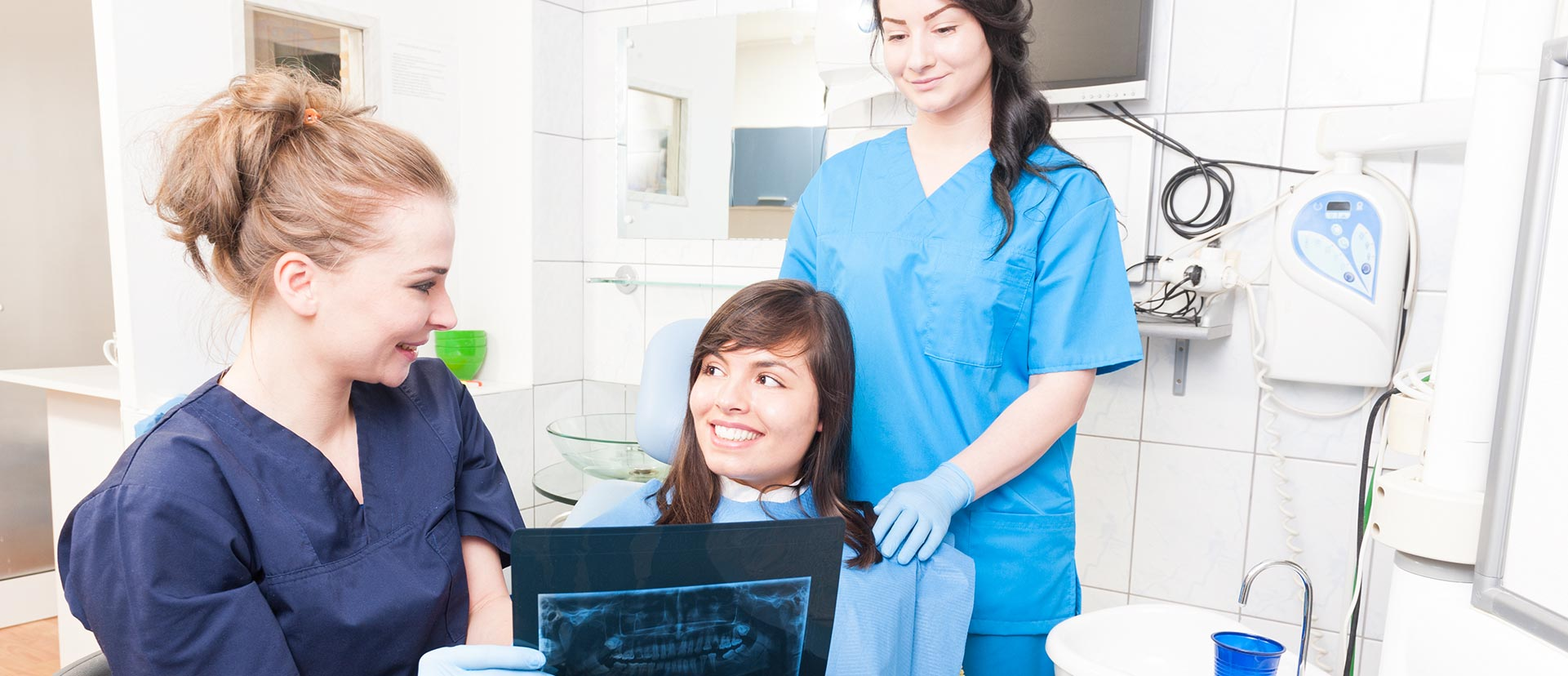 Dentist showing a x-ray report to patient