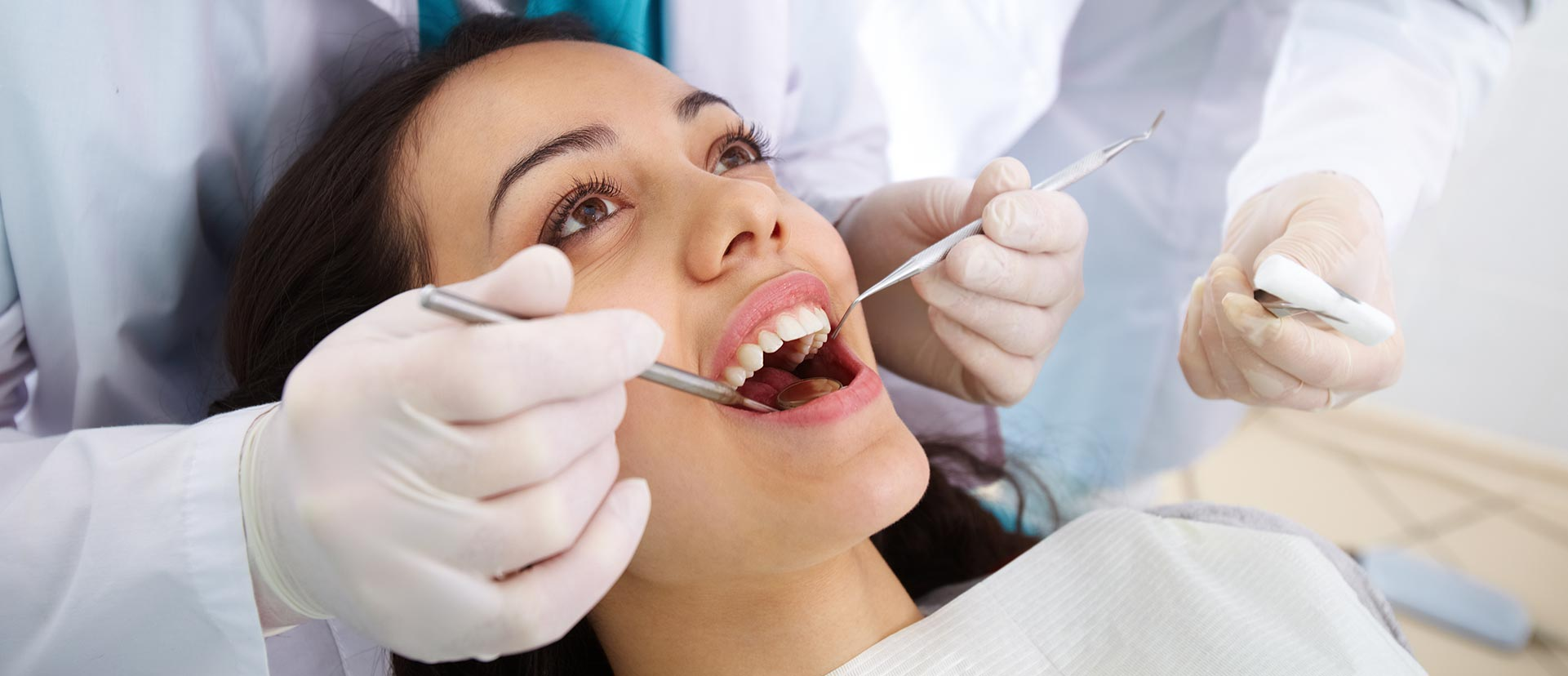 Woman having a composite filling at the dental